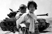Girl with brother during Korean War