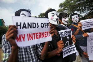 Protestors with Guy Fawkes masks demonstrating against government censorship of the internet.