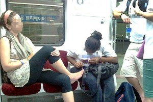 Foreign manicure girl on subway