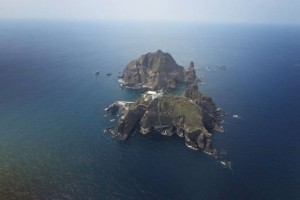 The contested islands lie in the East Sea, and are named Dokdo by Koreans, and Takeshima by Japan.