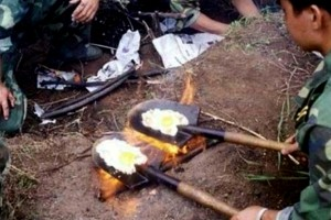 A South Korean soldier fries eggs on a shovel. Image for illustration purposes, obviously.