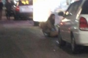 female-student-kneels-on-roadside-following-orders-from-senior