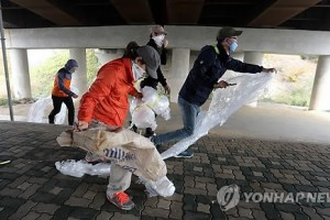 Young people ripping up balloons meant to carry anti-North Korea leaflets.
